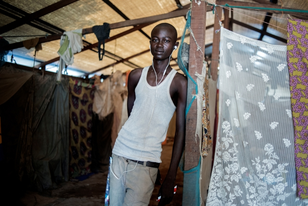 MSF159640<br/>Portrait of 20 year old Jordy at a displaced persons camp in Benzvi, Bangui.<br/><br/>Jordy comes from Bossangoa. Together with some friends, he fled the violence to find refuge in BenZvi camp, after one week on the road.<br/><br/>He survives thanks to the help of families who live in the same shelter as he does. The rest of his family is still in Bossangoa and he would like to return but cannot do so due to a lack of money.