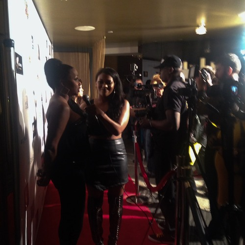 On the red carpet facing the press.