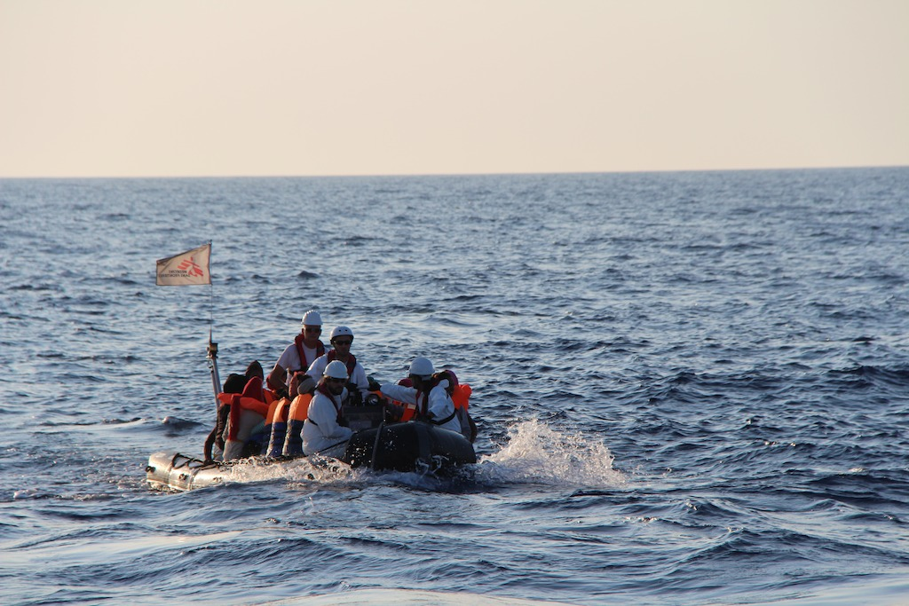 Rescuing the first people and bringing them safely back on board of Dignity I. Photo: MSF