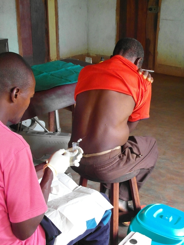 MSF mobile medical teams are spending 8 months travelling through DRC and aim to test and treat 42,000 people for sleeping sickness.<br/>Once the parasite is detected, a painful lumbar puncture must be made to examine the patient's cerebro-spinal fluid. This will determine the stage of the disease and the appropriate treatment for the infected patient. Photographer: Philipp Frisch/MSF