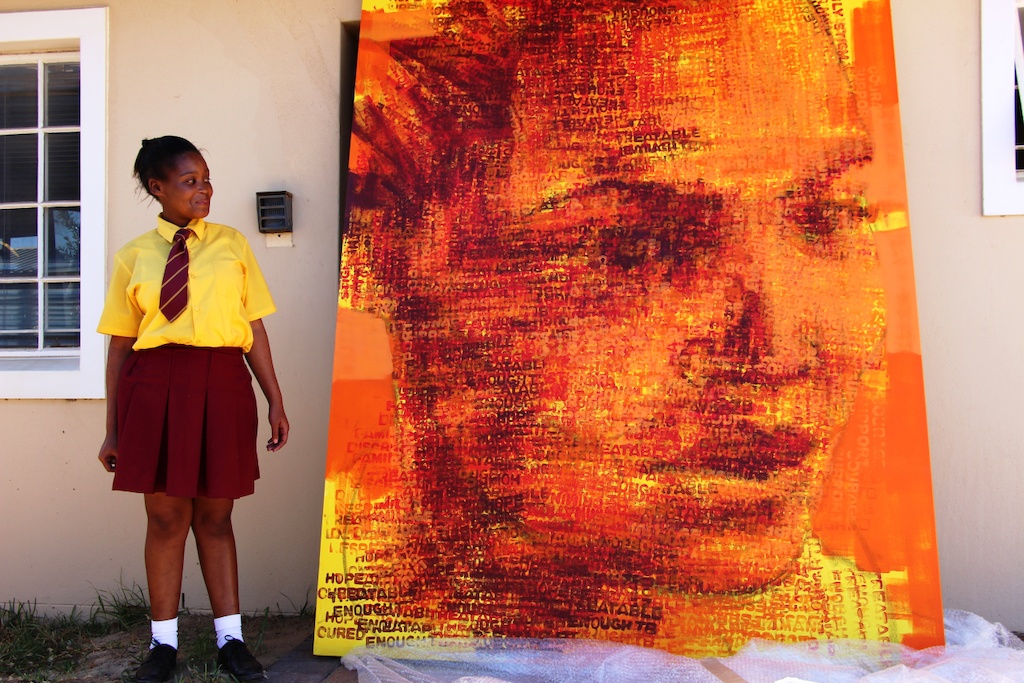 Sinethemba Kuse with her portrait / artwork. Photographer: MSF