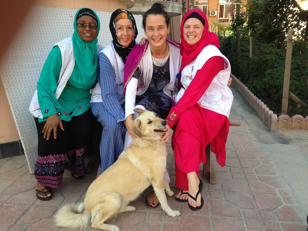 Thomas (R) and expats with MSF dog outside compound (photo credit: Dr Kathleen Thomas)