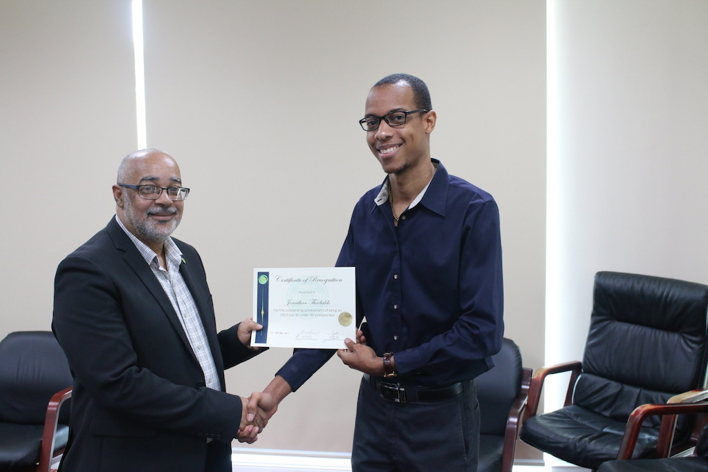 Jonathan Theobalds, 30 under 30 winner and Dr. Didacus Jules, Director General of the OECS