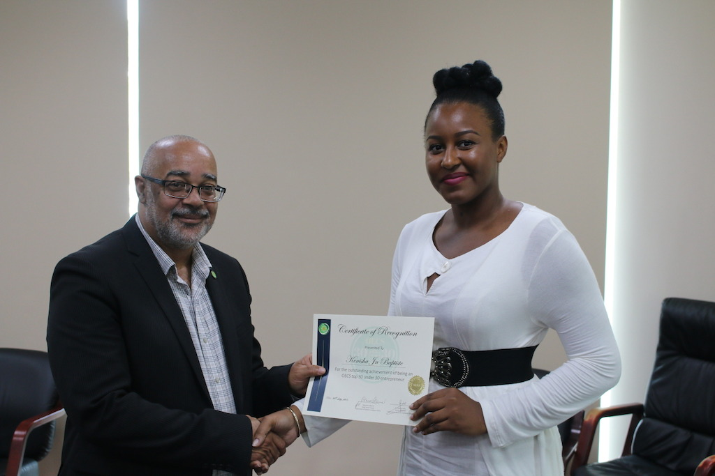 Kenisha Jn, 30 under 30 winner and Dr Didacus Jules, Director General of the OECS Commission