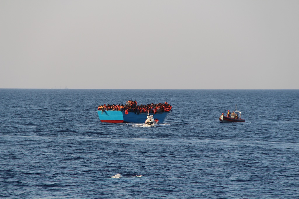 Dignity RHIB approaching wooden boat with approx. 600-700 ppl on board. Photo: MSF