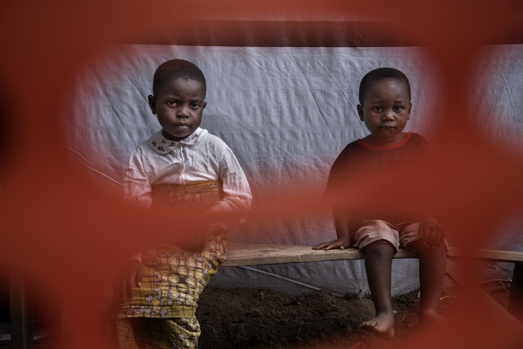 Two children who have almost recovered at the cholera treatment centre in Minova. They are waiting for the doctor for a final check-up before they are discharged. Photographer: Arjun Claire