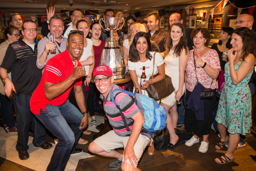 Henry Burris poses with fans and the Grey Cup inside the Maple Leaf Sports Bar and Grill. Photo Credit: Jim Ross/CFL