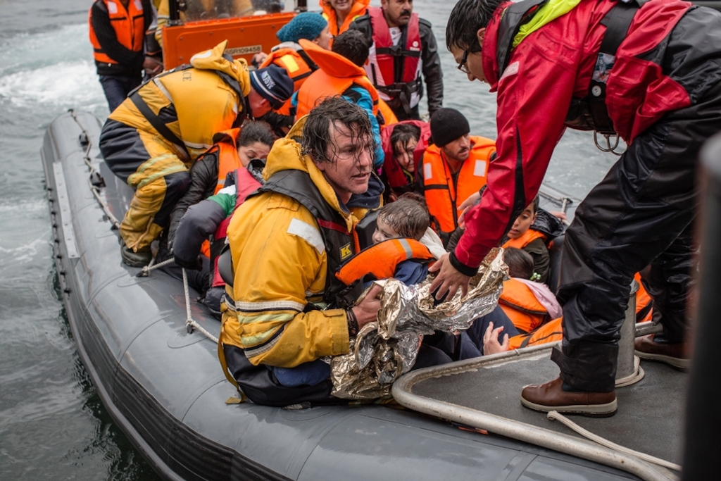 Photographer: Will Rose<br/><br/>Caption:  Doctors Without Borders (MSF) and Greenpeace boat crews responded to an emergency on December 16 as a wooden refugee boat capsized about mile and a half off the coast of Lesbos. On arrival to the scene all refugees were in the water and a major rescue operation involving Greenpeace, MSF, Frontex, Sea Watch and Proactiva ensued. A total of 83 people were rescued, while two people drowned - an 80-year-old man and nine