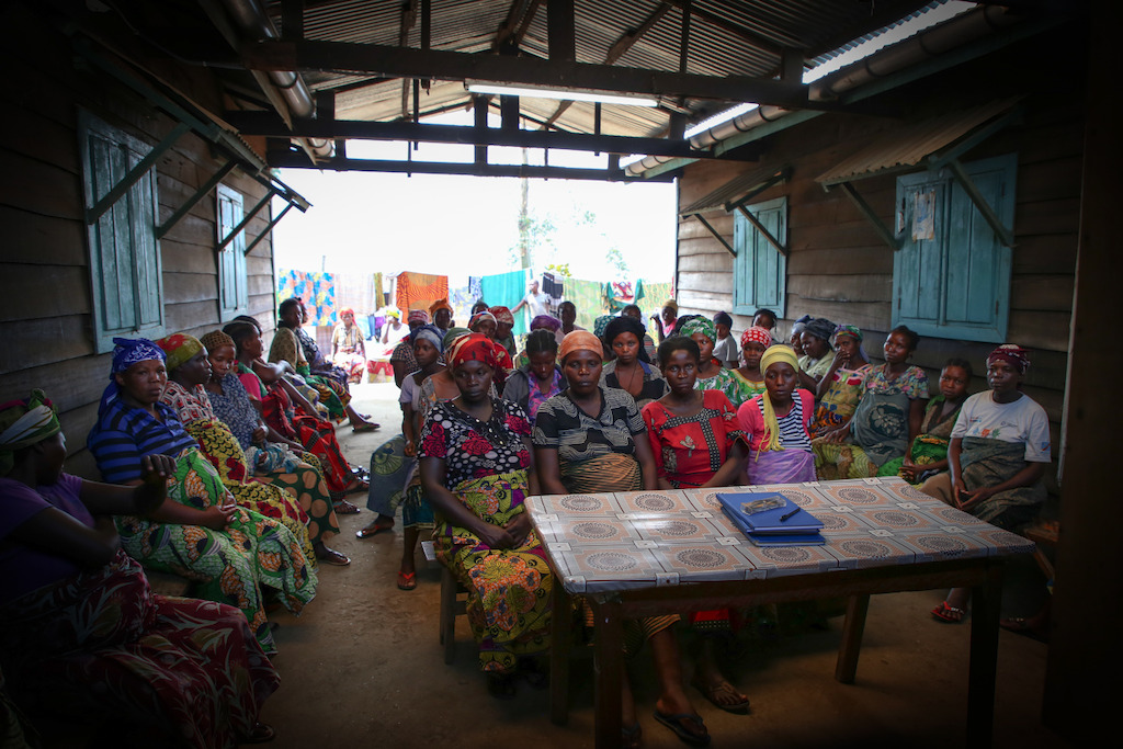 Women waiting to give birth at the 'welcome village' for pregnant women at the Masisi Hospital in The Democratic Republic of the Congo. Women may be accompanied by another woman to help prepare meals for them, or bring their younger children if there is no one to care for them while they are staying at the facility. Photographer: Sara Creta