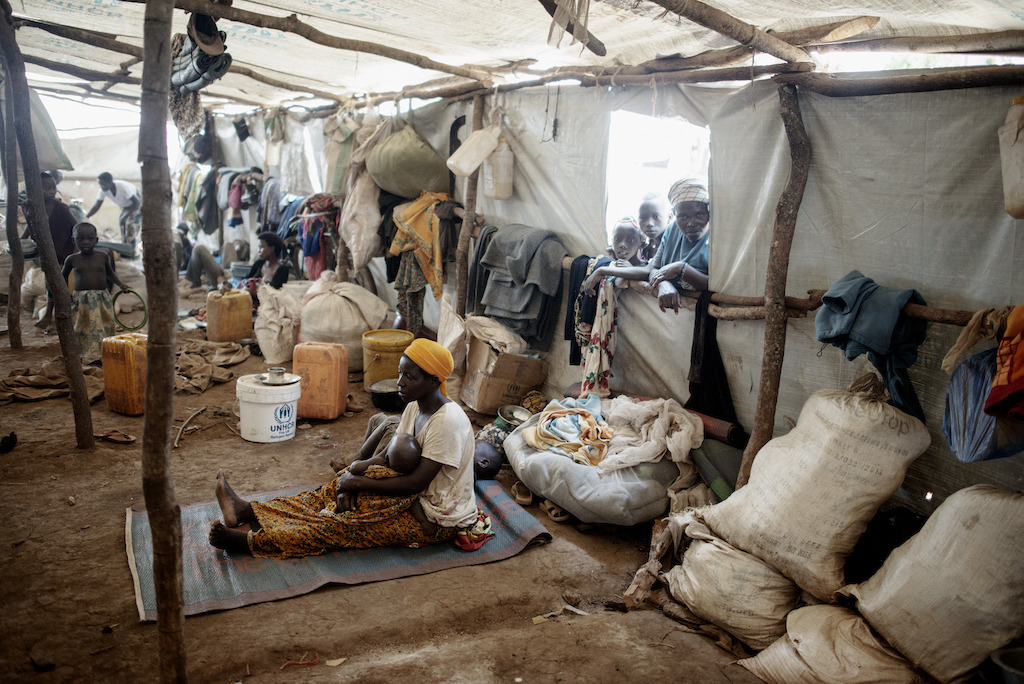 Inside one of the mass shelters in Nyarugusu camp. The shelters were built to house 200 people, but in some cases, they host up to 370. Photographer: Luca Sola