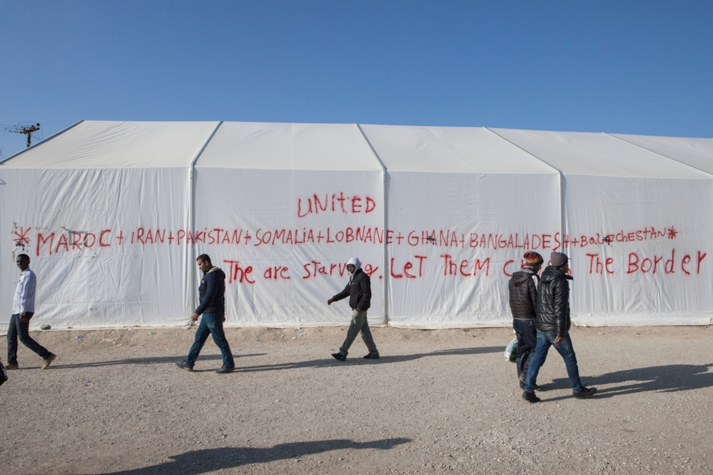 Photographer:  Alex Yallop<br/><br/>Caption: Graffiti sprayed onto a tent in support of the several thousand people have been stranded in at the Greek/Macedonia border unable to cross due to nationality restrictions put in place by several Balkan nations. At a makeshift refugee camp in Idomeni, Greece near the border with Macedonia.