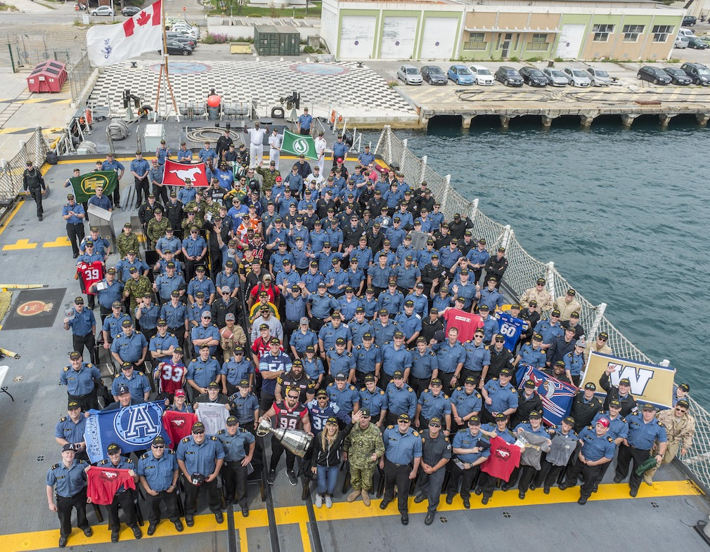 CFL players and members of the Canadian Forces aboard the H.M.C.S. St. John's in Marseille, France