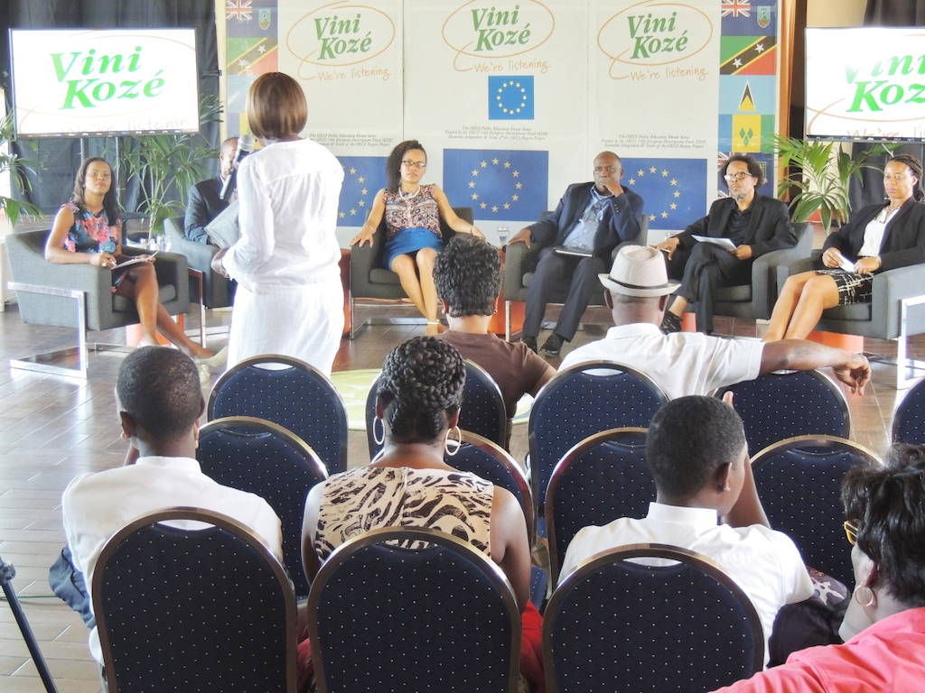 Member of the audience engages with the panel at the Vini Koze Forum on Economic Growth in Grenada.