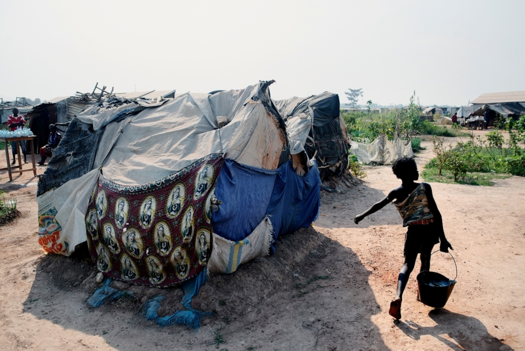 General view of the a displaced persons camp in M'Poko, Bangui. Photographer: Luca Sola
