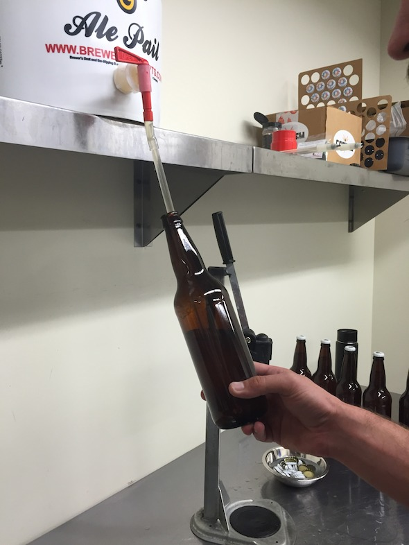 William Brant of CO-Brew fills sanitized bottles with the cantaloupe gose