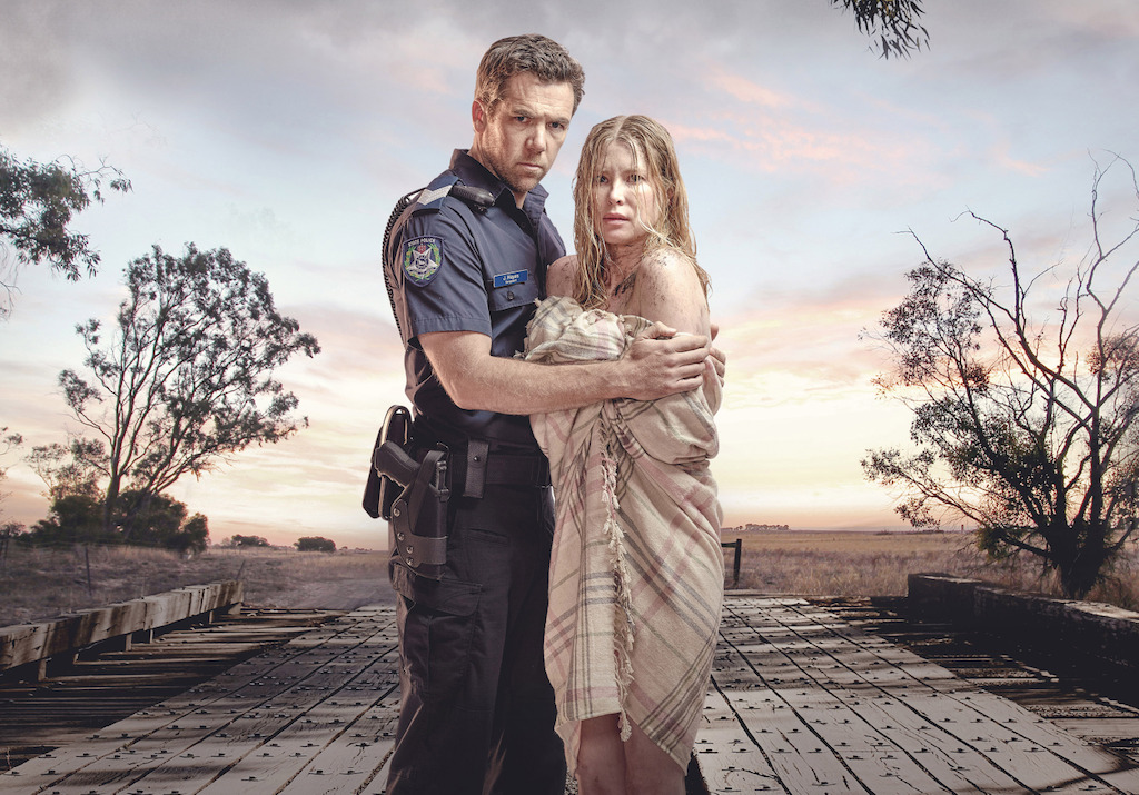 Patrick Brammal and Emma Booth in Glitch
