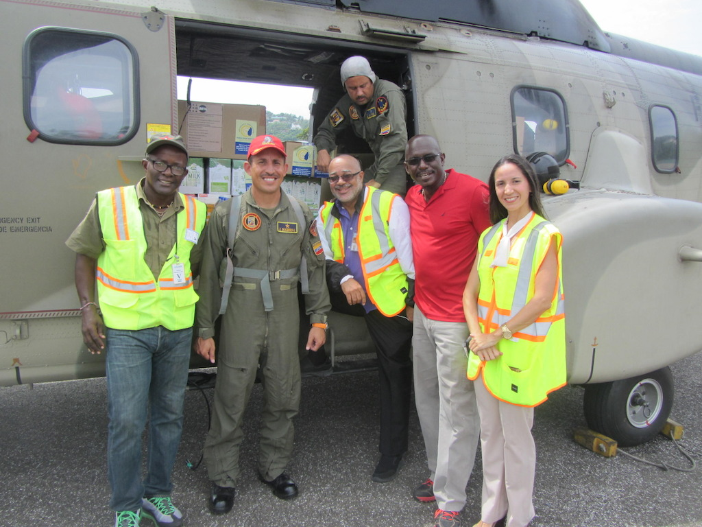 A Venezuelan Helicopter drop prepares to leave: (L to R): Former Non-Resident Ambassador to Petro-Caribe and ALBA, Eustace Vitalis, Venezuelan Flight Operations Manager, OECS Director General, H.E Dr. Didacus Jules, Grenada's Ambassador to the OECS H.E Dr. Patrick Antoine and Venezuela's Ambassador H.E Leiff Escalona.