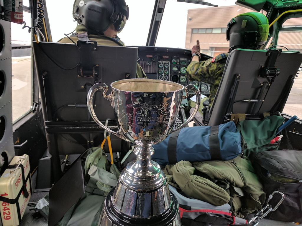 The Grey Cup aboard a CH-146 Griffon helicopter.