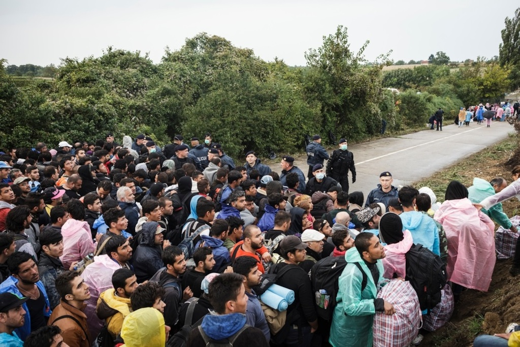 Photographer: Achilleas Zavallis<br/><br/>Caption: Refugees and migrants wait on the Serbian side of the Bapska border crossing hoping to enter Croatia.