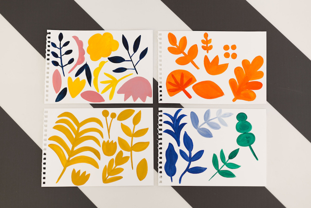 Photograph of the hand-painted bold flowers, that were then cut out and crafted into a flooring deisgn