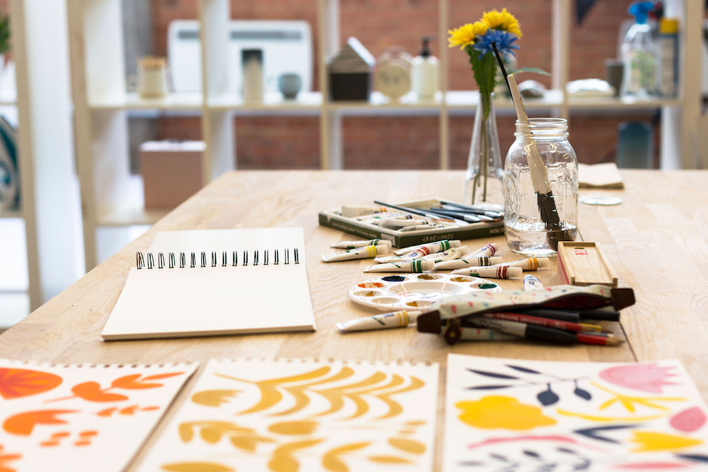 The creative studio set up for the in-house designers to paint away