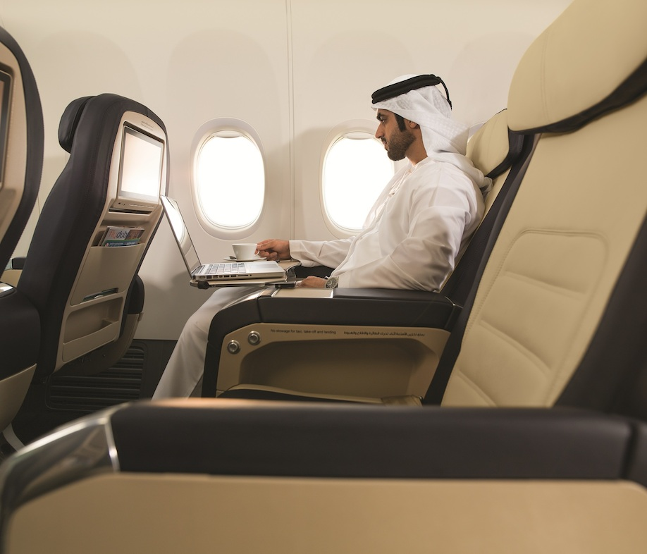 Business Class passenger using laptop