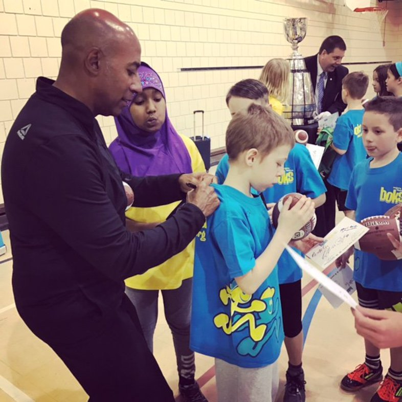 Commissioner Jeffrey L. Orridge signing autographs at Ecole Centennial Community School