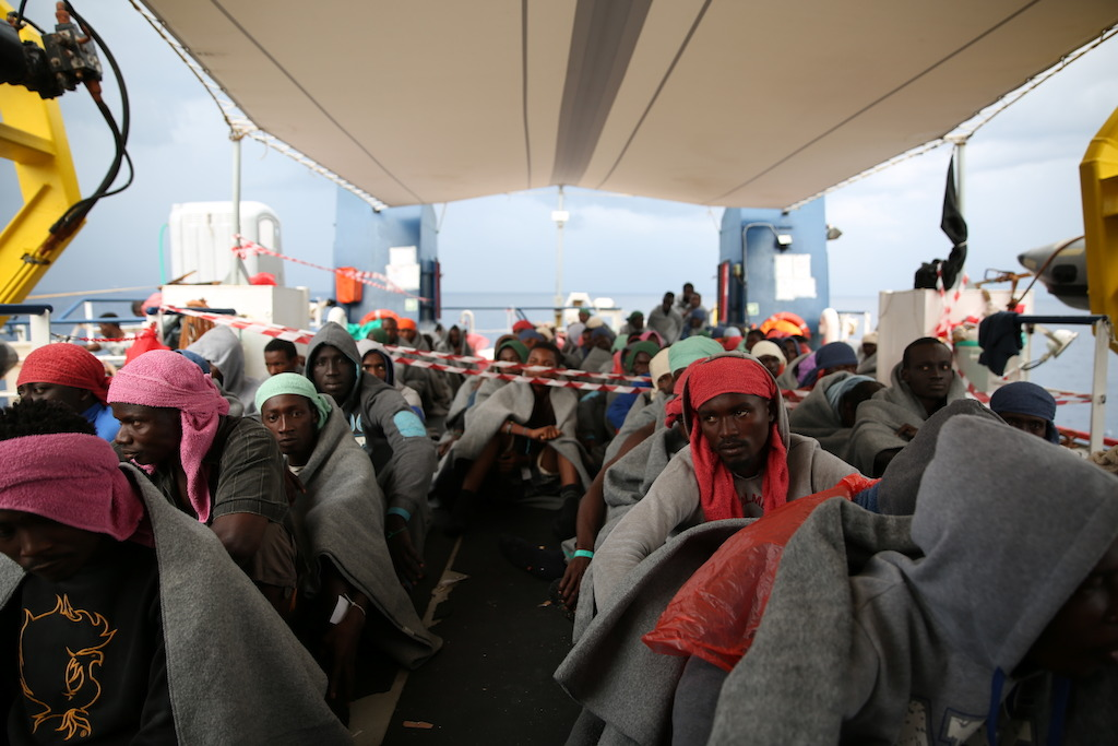 Rescued people preparing to disembark in Italy on 5 October. Many of the people who risk their lives through the Central Mediterranean route also have a nightmarish stop in Libya where, according to interviews with hundreds of people conducted by our medical teams, many suffer detention, sexual violence and torture. Photographer: Mohammad Ghannam