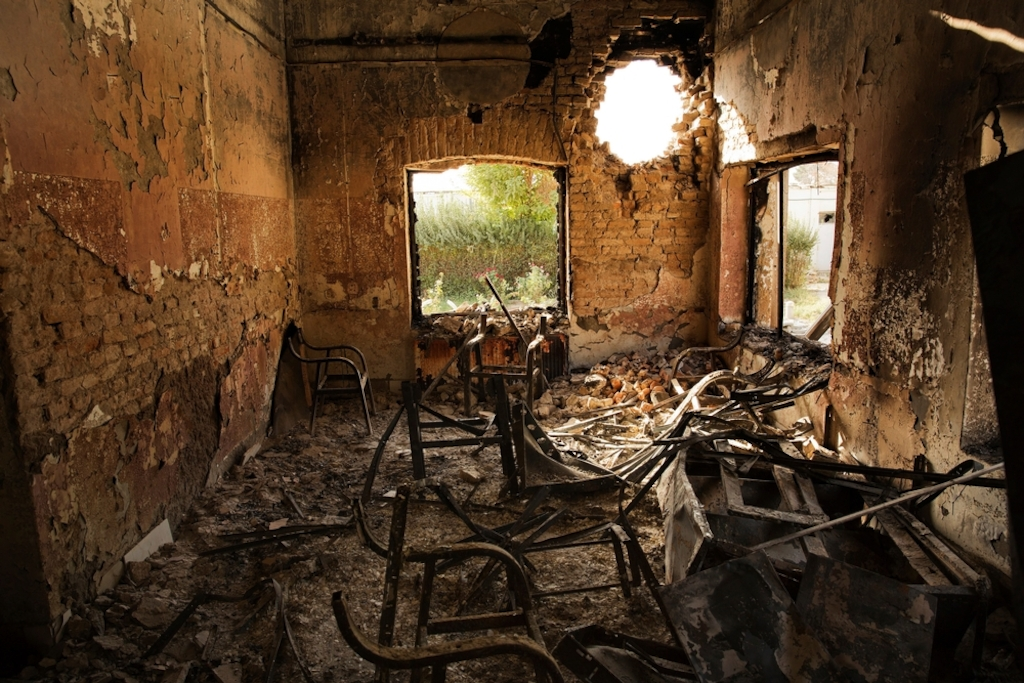 System identifier<br/>: MSF154407<br/>Title<br/>: Kunduz Hospital Aftermath - 14 Oct 2015<br/>Photographer / cameraman<br/>: Victor J. Blue<br/>Countries:<br/>Afghanistan Description:An interior view of the MSF Trauma Centre, 14 October 2015, shows a missile hole in the wall and the burnt-out remians of the the building aftera sustained attack on the facility in Kunduz, northern Afghanistan.