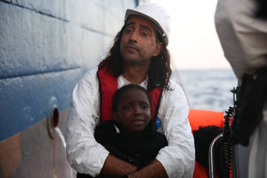 Me holding Nora - 8 years old from Nigeria - just before embarking Dignity I. Photographer: Mohammad Ghannam