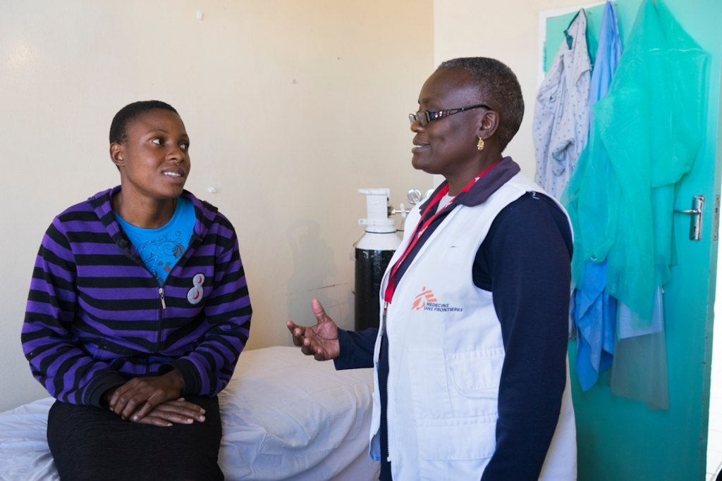 24 year old Tracy speaks with a member of MSF staff. <br/><br/>Tracy had HPV and was tested for VIAC without knowing it. They discovered in November 2015 more than 75% lesions. SHe was referred to Harare, thanks help from Medecins Sans Frontieres (MSF), and LEEP. Her son was hit by a car 3 weeks ago, so she has been stuck at Gutu Mission Hospital with him and has not been able to go back to VIAC test to see if the lesions are still there. Photographer: Melanie Wenger/COSMOS