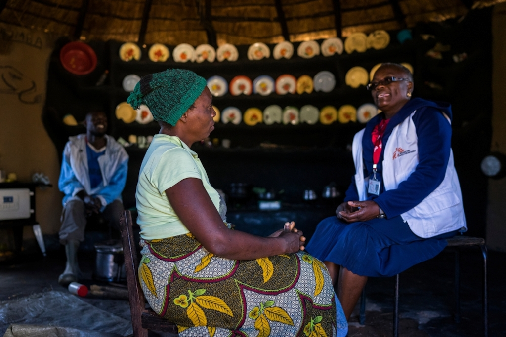 "Beauty (36) and her husband Mr Chigouriemba (28) talk with MSF nurse mentor Sister Tendai about the possibility if having a child before having her uterus removed.<br/><br/>Testimony taken in March 2017<br/><br/>""When I met Charles six years ago, I told him I was living with HIV and had three children, but he still wanted to marry me. We desperately wanted to have a child together. <br/><br/>Seven years ago, I lost my older sister to cervical cancer, and was worried it might happen to me as well. We only found out that she had cancer when it was too late and she had come home to die.<br/><br/>In September 2015, I had pain in my abdomen. I heard from a friend about the screening at Gutu rural hospital, so I went. <br/><br/>The test results showed I had lesions that couldn't be treated at the local clinic. MSF took me to Newlands clinic in Harare and paid for the procedure. The hospital told me it was serious and advised me to have my uterus removed, but, less than a month afterwards, I found out I was pregnant.<br/><br/>We both wanted it [a child], but my husband was torn because he didn't want to lose me. <br/><br/>Throughout my pregnancy I had regular check-ups, and the doctor booked me for an elective caesarean to prevent any risks.<br/><br/>Our baby is two weeks old now, and we are both so happy. I've been advised to have another test for cervical cancer six weeks after my delivery. Now that we have a child, I'm fine with any course of treatment, even a hysterectomy.<br/><br/>My strong message is that every woman should get screened, there's no shame in it. I would have stayed in the dark if I hadn't been screened."" Photographer: Melanie Wenger/COSMOS"