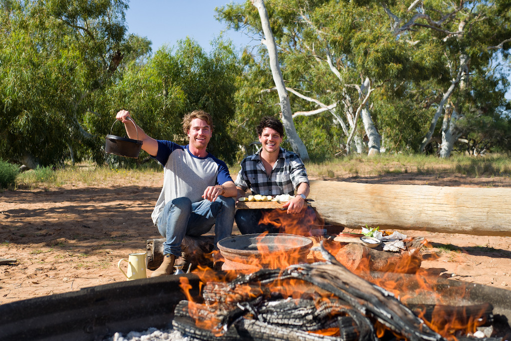 Hayden and Dan cook on the open fire