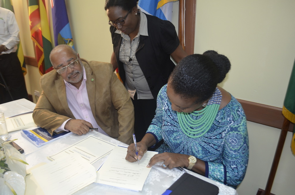 Ms. Shirlene Nibbs signing the ECIT Partnership Agreement on behalf of the ABHTI.