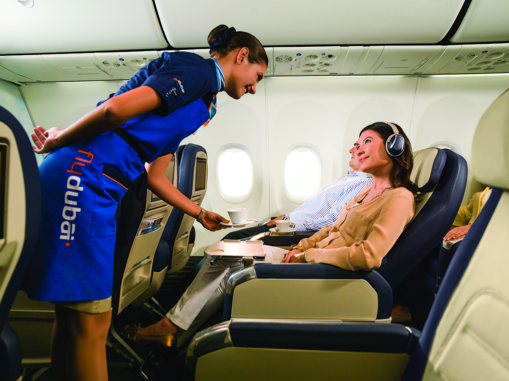 Business Class passengers being served by cabin crew