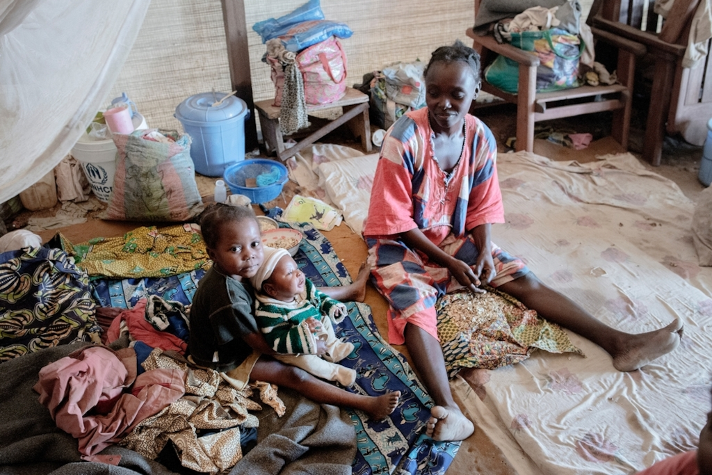 MSF159633<br/>Nadège is the mother of three children, two daughters, Gabriella and Abigaille, and a boy born one month ago, named Prosper. Nadège gave birth in BenZvi camp helped by a traditional midwife.<br/><br/>Ethna (see MSF159672) and Nadège are friends and used to live in the same neighbourhood. When violence broke out in December 2013, they decided to flee their home district in KM5 in Bangui.<br/><br/>Armed groups killed Ethna&#039;s grandfather and looted her whole house. Following the attack, she fled at first to the Saint Jacques camp but there was not enough space in the church, so they decided to flee again to Benzvi camp. She has been living in this camp for almost two years now. <br/><br/>The two women are unmarried and to survive, they sell cakes on the street. &quot;We eat only once a day.&quot; <br/><br/>Since they moved in to the camp, Ethna and Nadège's children have fallen ill with malaria several times, but have received treatment by Medecins Sans Frontiers (MSF's) mobile clinic.<br/><br/>Sometimes, they try to return to their home area to see if they can go back there but it still very insecure.