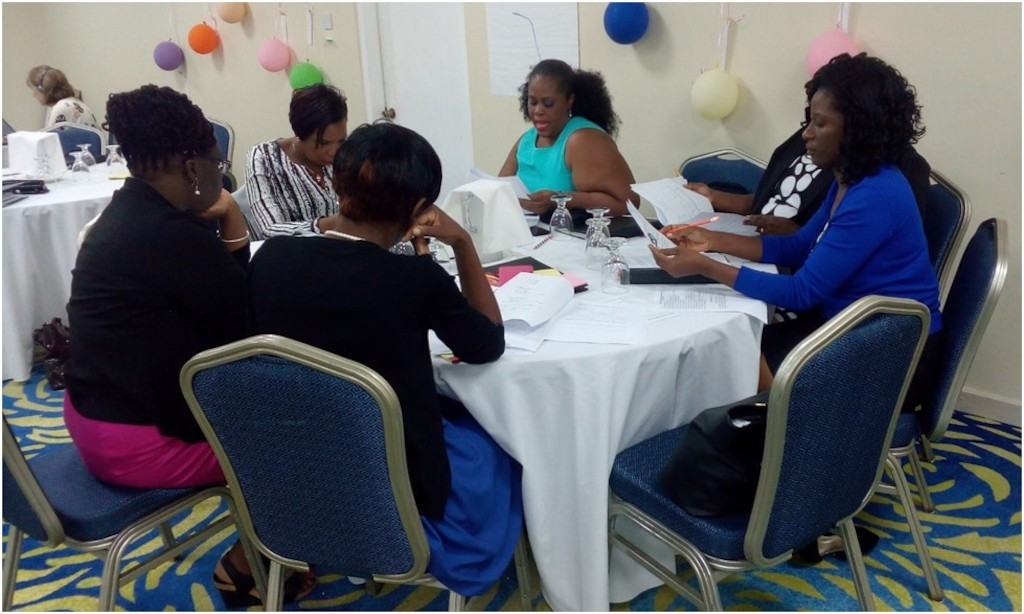 Team Antigua and Barbuda engage in discussions.