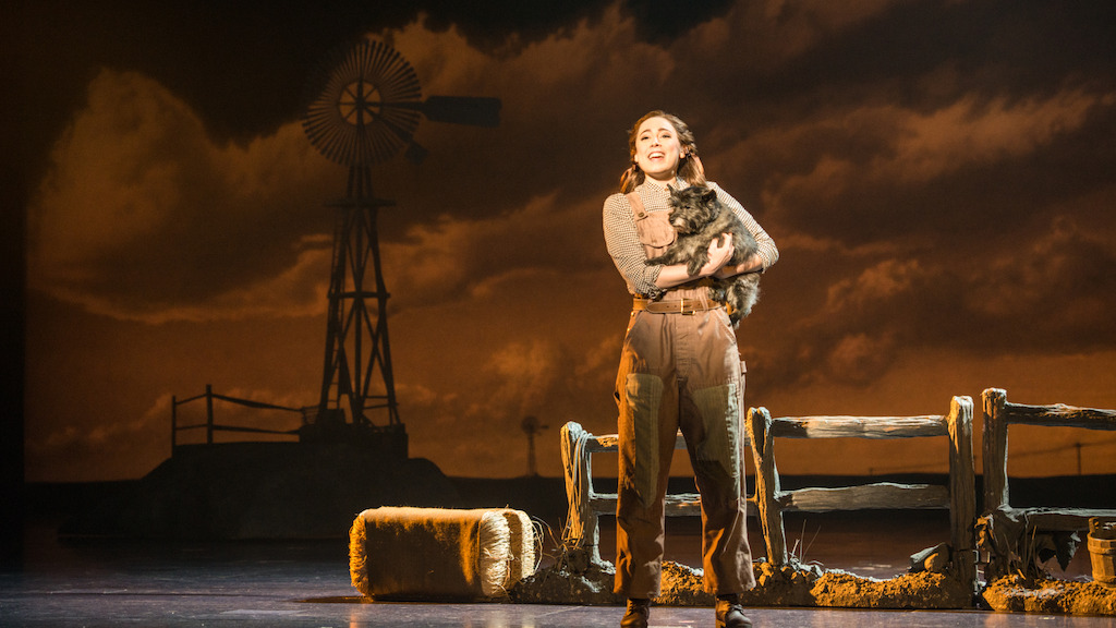 "Sarah Lasko as Dorothy and Nigel as Toto in ""Over The Rainbow""<br/>Photo credit: DANIEL A. SWALEC"