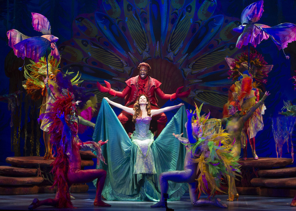 Melvin Abston as Sebastian, Alison Woods as Ariel and the cast of The Little Mermaid.  Photo by Bruce Bennett, courtesy of Theatre Under The Stars