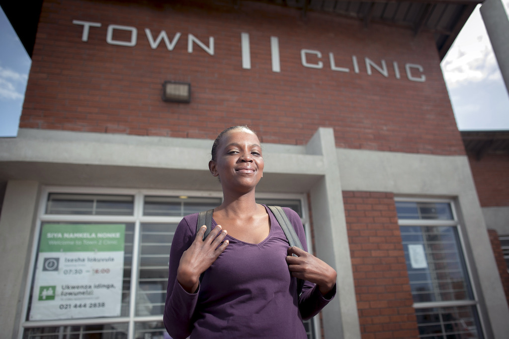 Sibongile leaves the Town 2 Clinic following her consultation. Kuyasa, Khayelitsha, Western Cape, South Africa.<br/><br/>Simbongile's current DR-TB regimen: bedaquiline, linezolid, clofazimine, terizidone, levofloxacin, pyrazinamide. Photographer: Sydelle WIllow Smith