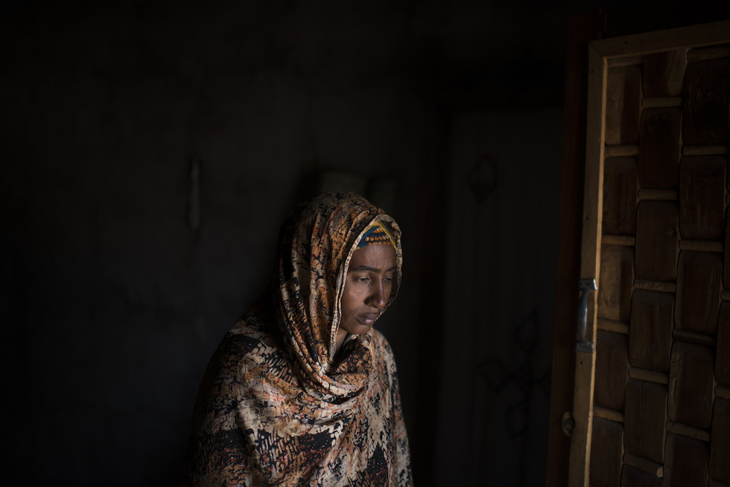 "Credit Colin Delfosse. Jamila, widow from Bria. ""My husband was killed at home on the 21 November 2016 when the neighbourhood was attacked. I stay here with my six children, with no help whatsoever. Without my husband, I don't know how to feed my family. We're afraid to leave the neighbourhood, we don't have freedom anymore. We have suffered a lot in the past four months. At night we don't sleep, we fear renewed attacks."""