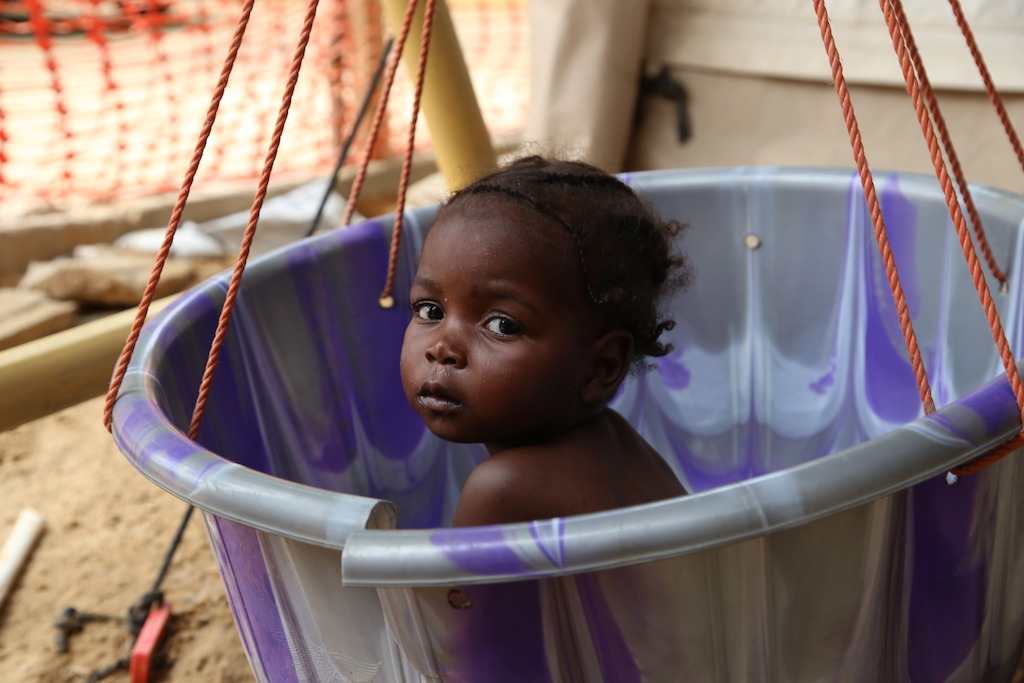 A young girl is weighed at the MSF inpatient therapeutic feeding centre in the northeastern Nigerian town of Banisheikh. Photographer: Igor Barbero