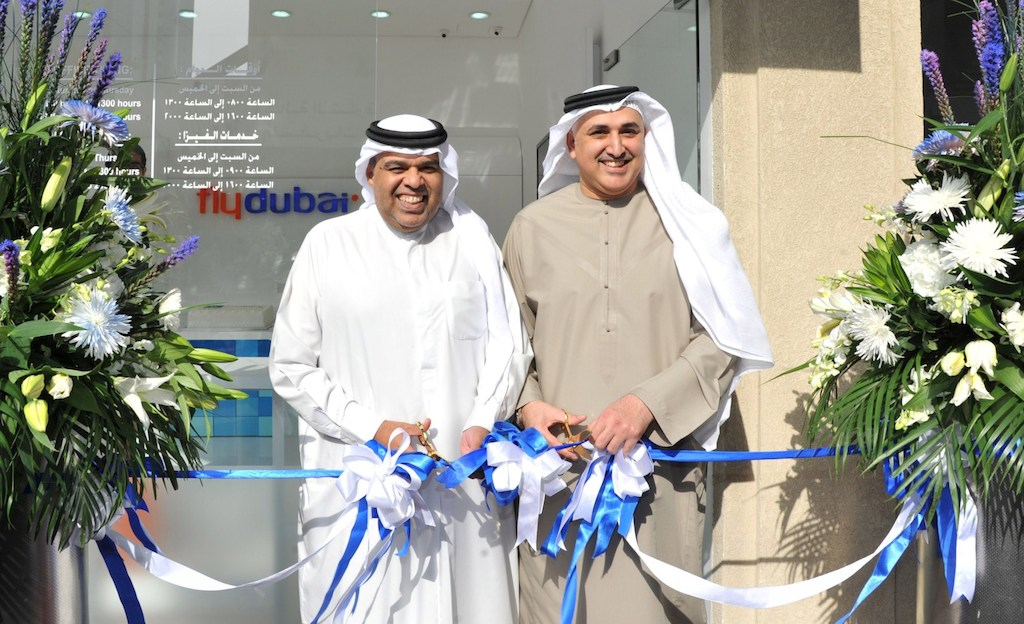 Hamad Obaidalla (left) and Sheikh Khalid Abdulaziz Al Qasimi open the new flydubai Travel Shop in Sharjah