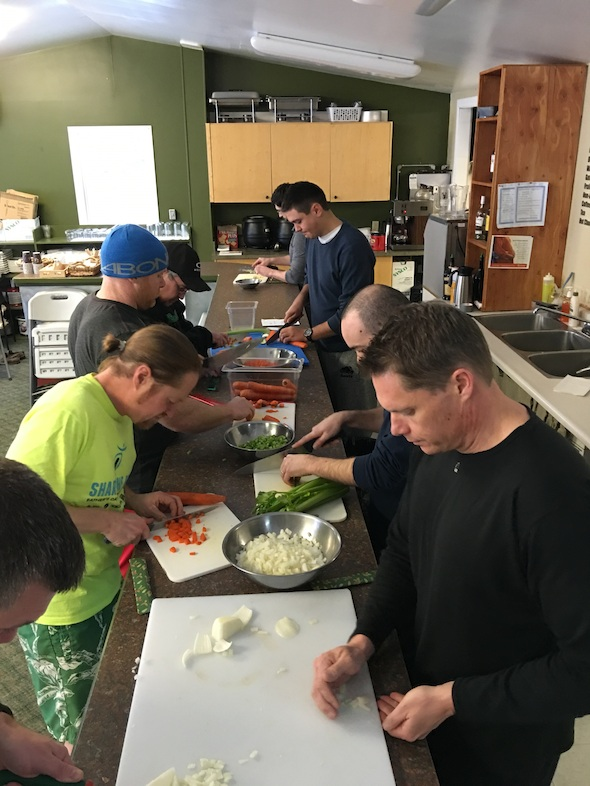 Wellmen participants during a cooking activity.