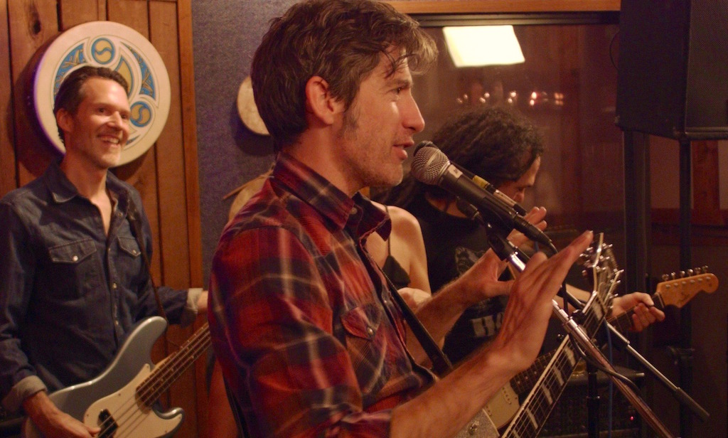 Colin Gilmore and band - still from The Shopkeeper