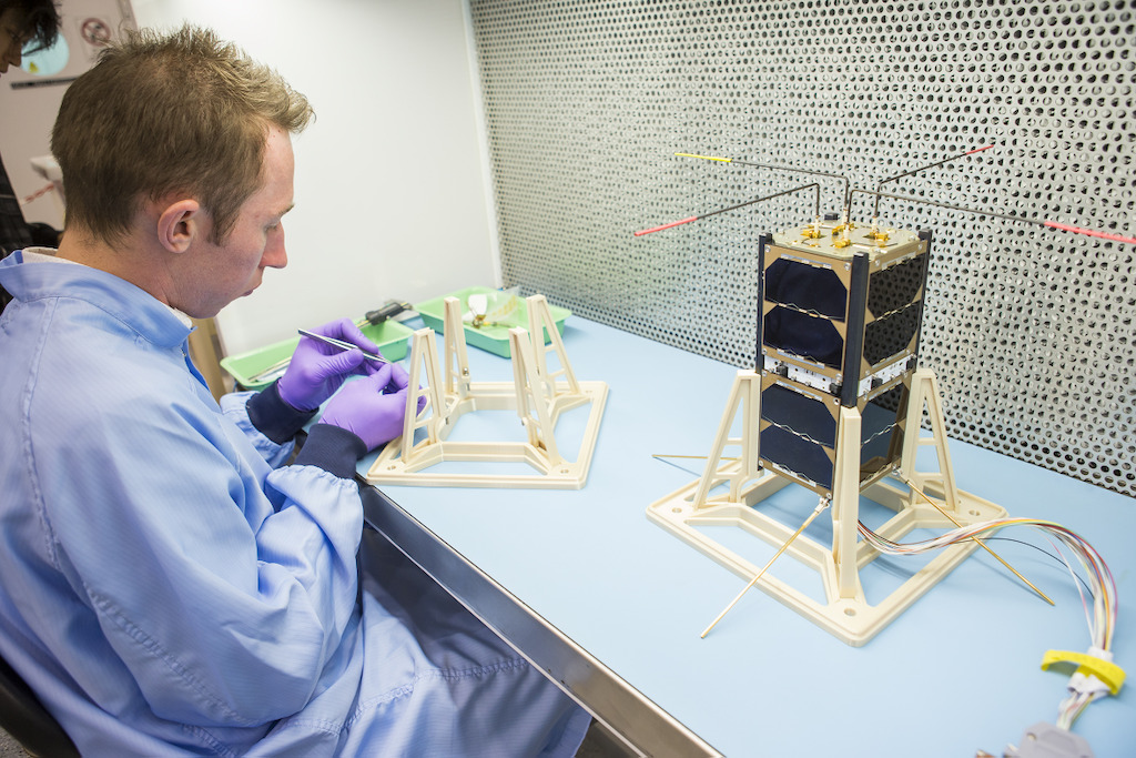 ANU engineer Bart Fordham with one of the Australian CubeSats. Image: Stuart Hay, ANU.