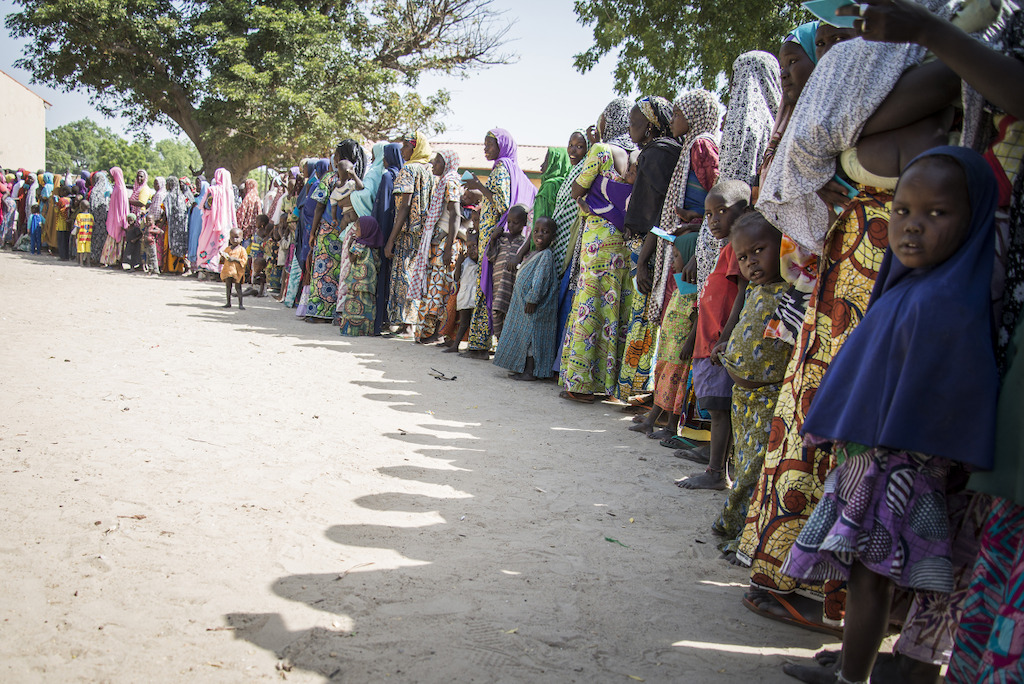 Food Distribution in the IDP site of Goni Kachallari in Maiduguri north-east of Nigeria. 340 families received a ration for one month.<br/>The one month ration food include 5 liters of oil, 5 kg of beans, 25 kg of millet. Photographer: Aurelie Baumel