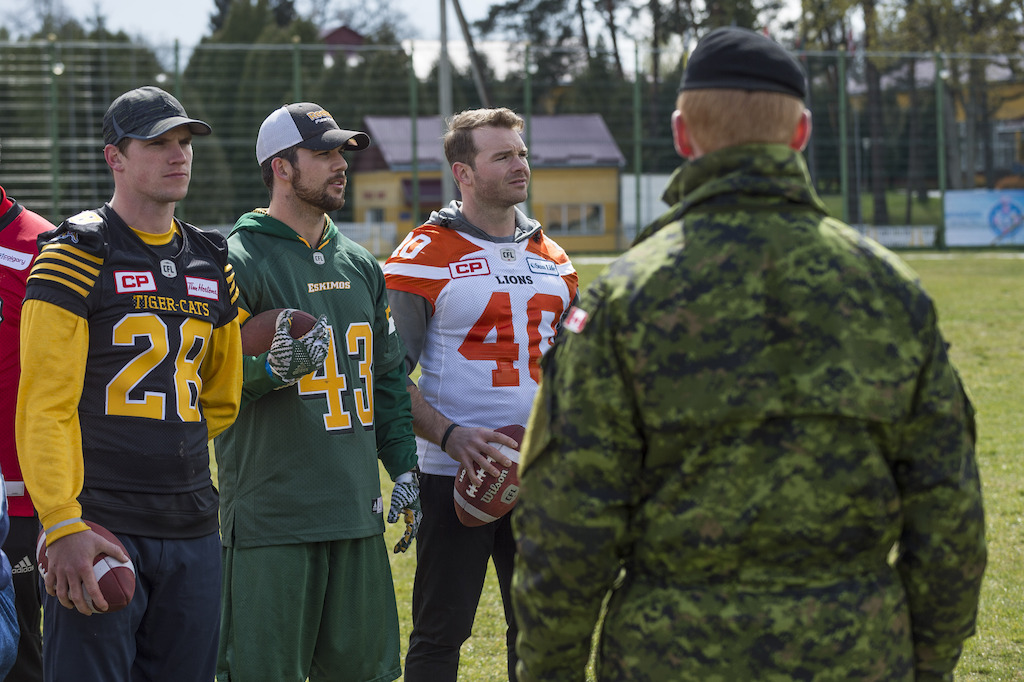 Craig Butler (L), Neil King (C), and Mike Benson (R) with members of the Canadian Forces in Lviv, Ukraine. Photo: MCpl Mathieu Gaudreault, Canadian Forces Combat Camera