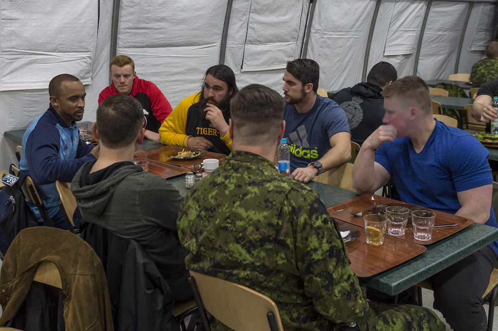 Matt Black (L), Andrew Buckley (C), and Mike Filer (R) in the mess talking to military members deployed on OP UNIFIER in Starychi, Ukraine. Photo: MCpl Mathieu Gaudreault, Canadian Forces Combat Camera