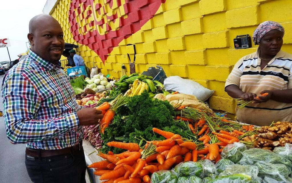 Minister Caesar visits market vendors in Dominica.